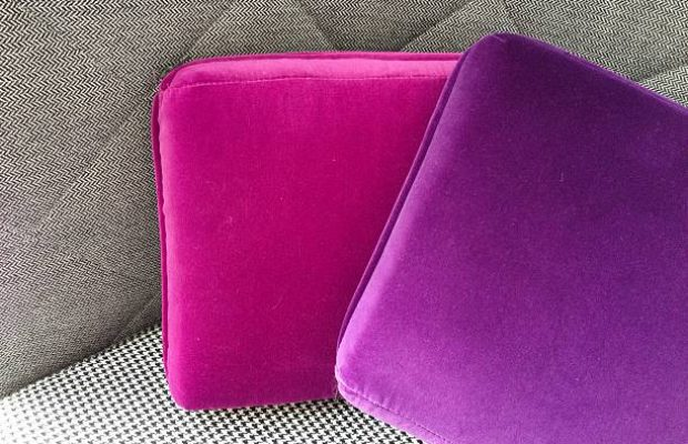 Velvet cushions in shades of purple.